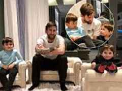 Barcelona star Lionel Messi relaxes at home with his sons