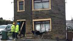 Car hits house during police chase in Bradford