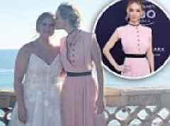 Jennifer Lawrence recycles pink dress for Schumer wedding