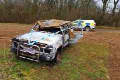 Police action: Jeep burned out, menacing-looking bat seized, suspect pursued on foot, and off-road bikers