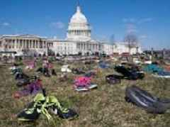 Shoes placed in front of Capitol for children killed by guns