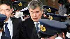 Japan finance official resigns over sex scandal
