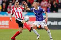 Fans react as Exeter City and Lincoln City record goalless draw in first leg of League Two play-offs