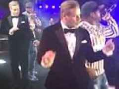 John Travolta displays his awkward dad dance moves with pal 50 Cent as clip of him goes VIRAL