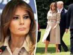 Trump clutches Melania's hand as she is seen close-up for first time