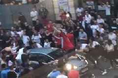 Watch moment England fan flies through air after jumping onto car during Tunisia World Cup game