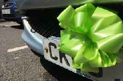 People are driving around with red and green bows tied to their cars in Swansea and this is why