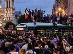 France fans swarm the Champs Elysses in celebration of World Cup final