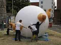 Pumping up Trump! Campaigners prepare for the presidential visit by inflating the Donald Trump baby