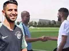 Riyad Mahrez meets new boss Pep Guardiola as he takes part in first Man City training session