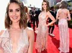 Alison Brie shimmers in a halter wrap dress while on the red carpet at the ESPY Awards