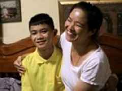 Thai cave boy treated to new phone and bed on first day at home