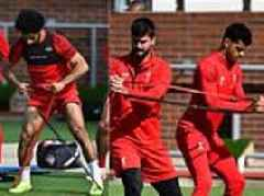 Liverpool players pair up for some resistance training ahead of visit to face Tottenham