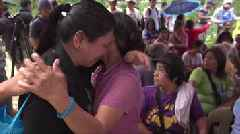 Typhoon relatives' wait for call that never comes