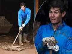 Tennis ace Rafa Nadal helps clean up after flash floods near his home in Majorca