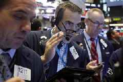 US stocks slip lower in wobbly trading, but losses ease