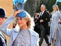 Poppy Delevingne cuts a chic figure in a powder blue gown as she attends Princess Eugenie's wedding