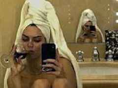 Kendall Jenner shares naked straight out of the shower selfie as she sips a glass of wine