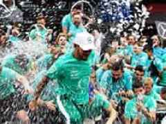Lewis Hamilton gives rallying pep talk to his victorious Mercedes team after title win