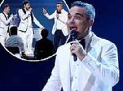 X Factor: Robbie Williams re-joins Take That but Dermot O'Leary makes awkward Jason Orange remark