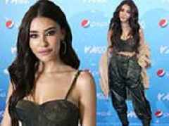 Madison Beer flaunts cleavage and flat stomach in camo corset at Jingle Ball in NYC