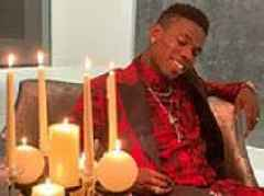 It's red for romance as sharp-suited Man United's Paul Pogba spells out 'I love you' with cookies
