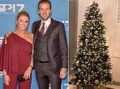 Kane gets in the festive spirit by topping his Christmas tree with golden boot