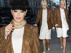 Rita Ora teams a chic checked blazer with a white shirt as she makes a low-key appearance