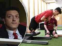 Mesut Ozil makes point to Unai Emery as he works out in gym amid omission from Arsenal squad