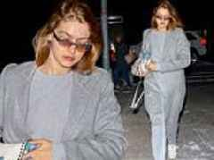 Gigi Hadid cuts a stylish figure in a gray coat with a coordinating sweatsuit in New York City