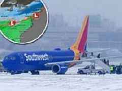 Winter storm barrels bracing -35F winds toward New England causing chaos with 5000 flights canceled