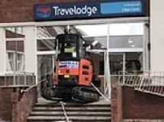 Digger driver smashes his way into new Travelodge hotel in bizarre rampage