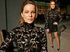 Kate Beckinsale dazzles in a flirty lace mini dress at Giambattista Valli's show Paris Fashion Week
