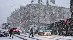 Ice warnings as snow surprises Scotland's commuters