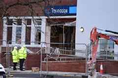 Digger destroys front of newly-built Travelodge hotel in 'row over pay'
