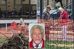 Rolf Harris walks onto primary school grounds waving at kids before being ordered off