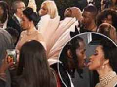 Cardi B and Offset touch tongues on the Grammys red carpet