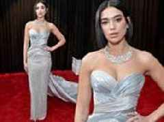 Dua Lipa looks like music royalty as she flaunts cleavage in silver dress and wins first Grammy