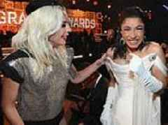 Cardi B befriends Lady Gaga at the Grammys as the two share a joke