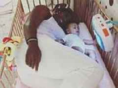Serena Williams is the image of motherly bliss as she climbs into daughter Olympia's crib to cuddle