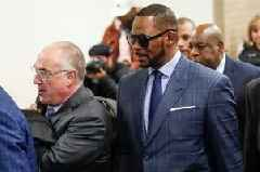 R Kelly jailed over child support debts during hearing in Chicago