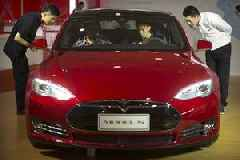 Tesla's deliveries fall to record low