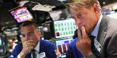Traders are holding their breath on evidence of a first earnings recession for three years