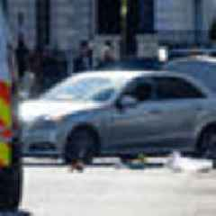 Police shoot into vehicle after it crashes into Ukrainian ambassador's car outside London embassy