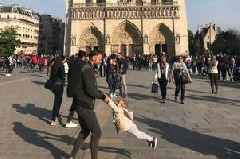 Search to find 'dad and daughter' in photo taken just an hour before Notre Dame Cathedral engulfed by flames