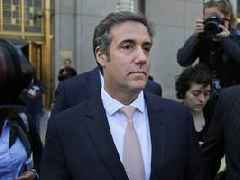 On his way to prison, Michael Cohen says 'much to be told'