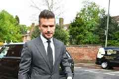 David Beckham gets a driving ban for six months for driving using his mobile phone