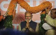 Pakistan hopeful, sceptical after Modi victory in India's election