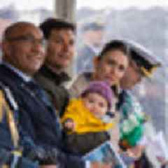 Baby Neve a babe in arms at Naval ceremony