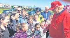 Flag-waving pupils' delight at meeting relaxed US President Donald Trump